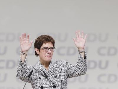 New leader of Merkel's party moves to consolidate power