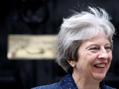 Theresa May confirms plan to keep UK wedded to EU rules after Brexit