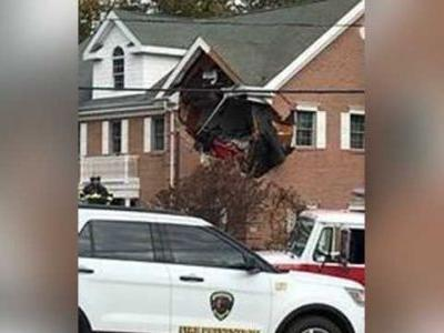 Speeding Porsche crashes into second story of building in New Jersey, killing 2 people