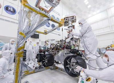 Ready to roll: Mars 2020 rover fitted with wheels ahead of mission next year