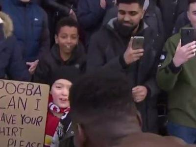 Paul Pogba shows his class by handing his shirt to young fan