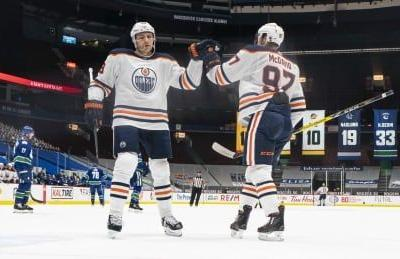 McDavid leads Oilers to playoff spot with win over Canucks