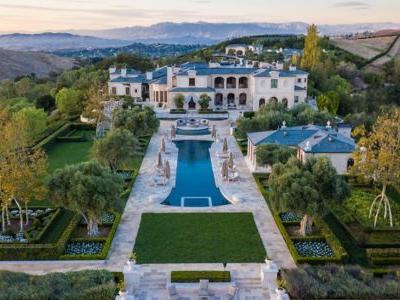 The billionaire producer behind 'Godzilla' and 'Jurassic World' just listed his LA mansion, complete with a Himalayan salt room and organic farm, for $85 million