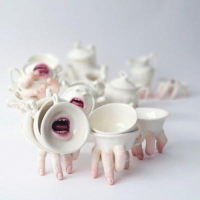 Itscolossal:Parted Ceramic Mouths and Clenched Hands Enliven Tea