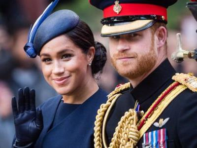 Meghan Markle Wore a Thing: Custom Navy Givenchy Cape and Cocktail Dress