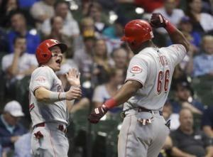 Reds withstand another homer by Yelich, beat Brewers 11-7