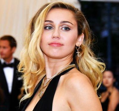 Miley Cyrus' New Tattoo Says Something About Her Breakup - & Kaitlynn Carter