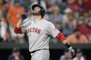 Martinez hits 2 of Boston's 6 HRs in 13-2 rout of Orioles