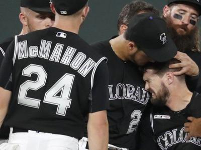 Rockies OF Dahl carted off field after injury