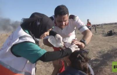 Journalist working with RT caught in tear gas attack amid deadly Gaza protests