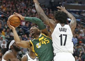 Gobert shakes off illness to lead Jazz past Nets, 114-98