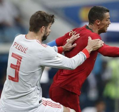 Cristiano is prone to diving - Pique slams Portugal star