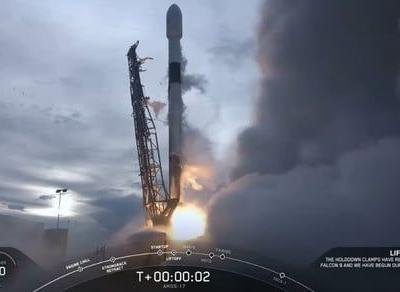 SpaceX launches a twice-flown rocket to deploy one massive satellite