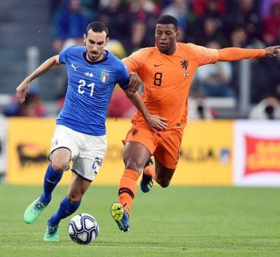 Netherlands score late to draw with Italy 1-1 in Turin
