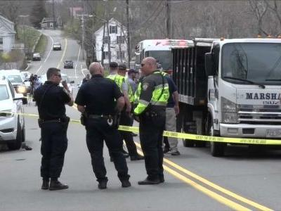 Police: Man charged with attempted murder after carrying woman into path of dump truck