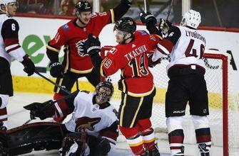 Coyotes' win streak ends in Flames rout