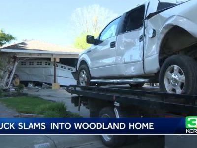 Truck Slams Into Woodland Home