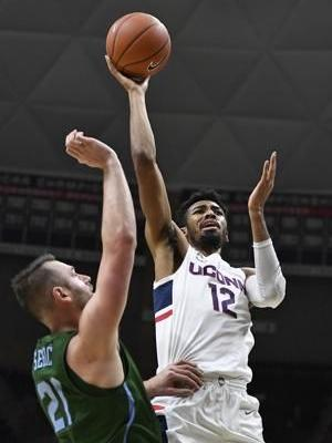 Adams scores 31 to lead UConn to 87-71 win over Tulane