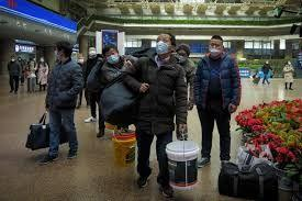 China's lockdown-wary cities urge migrant workers to avoid New Year trip home