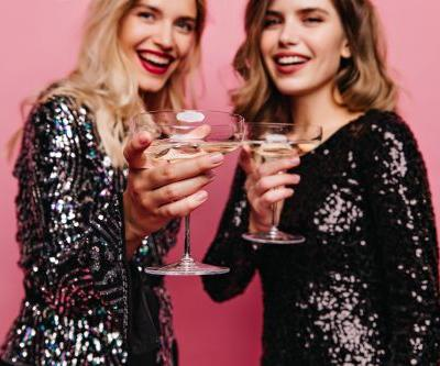 30 Clever Captions For Champagne Toasts That Sparkle Like Your NYE Outfit