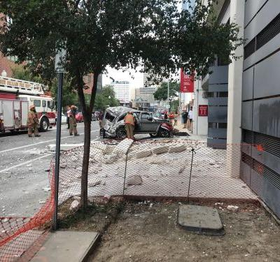 At least 1 taken to hospital after car crashes off parking deck in New Orleans