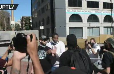 'Still think Antifa is just an idea?' Black conservative activist gets tooth knocked in clashes during free speech rally
