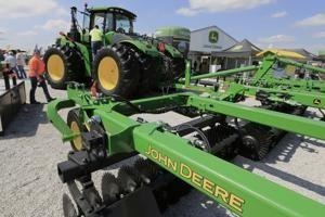 Deere; signs of stability on farm in bruising trade fight
