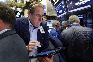 Stocks tick higher, S&P 500 flirts with record