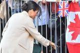 Meghan Markle's Latest Royal Visit Brought Back Her Messy Bun With a Ballerina Twist