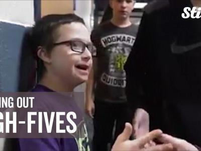 Middle school student shares smiles, high-fives with classmates
