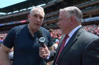 Blues coach Craig Berube enjoys the Cards game between Stanley Cup games