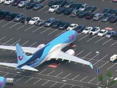 Boeing Has So Many Grounded 737 Max Planes Waiting to Be Fixed They're Parking Them in the Employee Parking Lot