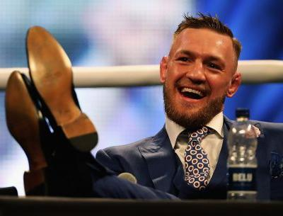 The coach of Conor McGregor, who just retired from MMA, says the ex-UFC star doesn't spend much money because his expensive clothes and cars are 'given to him'