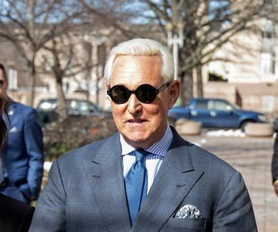 Judge slaps Roger Stone with gag order after crosshairs photo