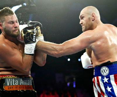 Tyson Fury scores 2nd-round TKO win in between putting on a show