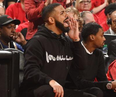 Drake begins his trolling of Warriors in a Dell Curry Raptors jersey