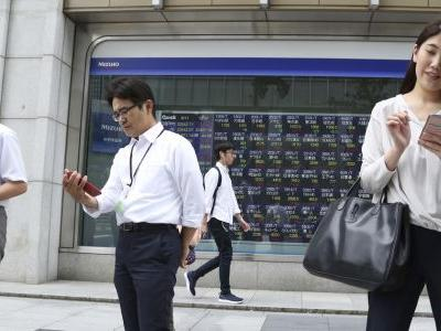 Asian shares rise as traders shrug off new China-US tariffs