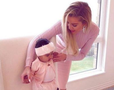 True's First Christmas! Khloé Kardashian Shares Pics Of Her Baby Girl In Front Of The Tree And It's Freaking Cute