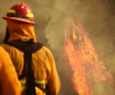 Firefighter dies while battling massive California blaze