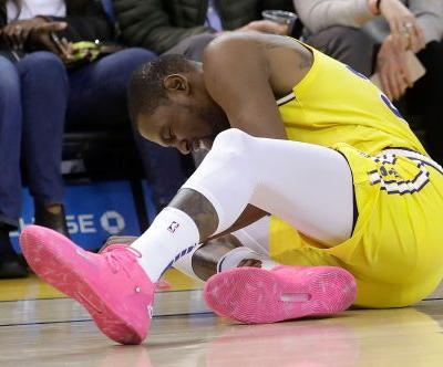 Kevin Durant injures ankle as Suns rally to stun Warriors at Oracle