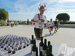 The Medoc Marathon meanders through vineyards and VINTAGE WINE is available at the drink stops