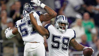Cowboys hold off Vikings for 11th straight victory