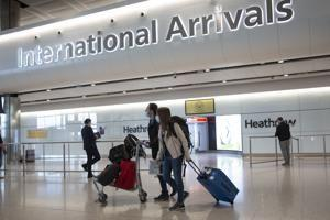 For holiday travel, England uses tests to reduce quarantines