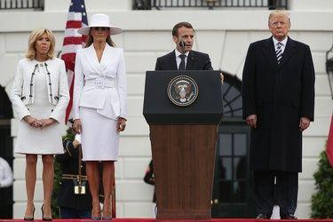 Melania Trump's White Hat When She Greeted The Macrons Got, Uh, Heads Turning