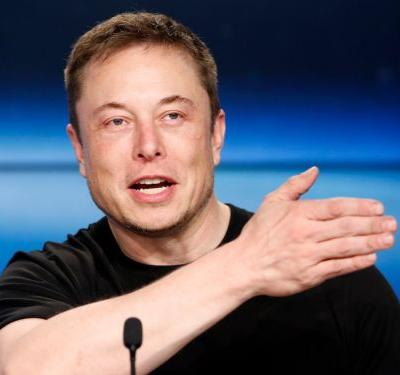 Elon Musk said Tesla will probably start installing the chip it designed to make its cars self-driving on older vehicles near the end of this year
