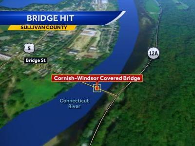 Man charged after box stuck hits covered bridge, causes minor damage