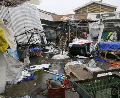 Powerful typhoon lashes Philippines, killing at least 12