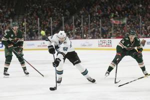 Jones shuts out Wild, Couture scores 2 in Sharks' 4-0 win