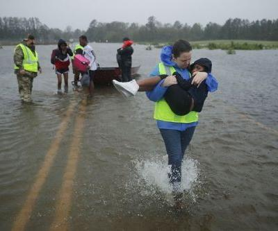 Florence death toll rises to 18, baby swept away