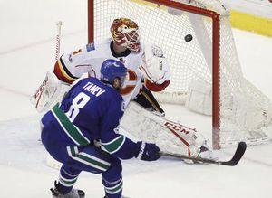 Tanev scores in overtime, Canucks edge Flames 2-1